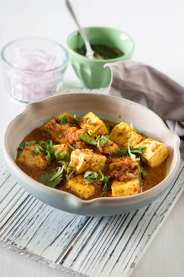 Paneer Balti Masala is a very popular dish of Indian and Pakistani restaurants in Britain. Fresh soft chunks of paneer in a bucket of spicy tomato gravy. This is a semi rich paneer curry made with freshly toasted and ground whole spices served in a cast iron wok called Balti.