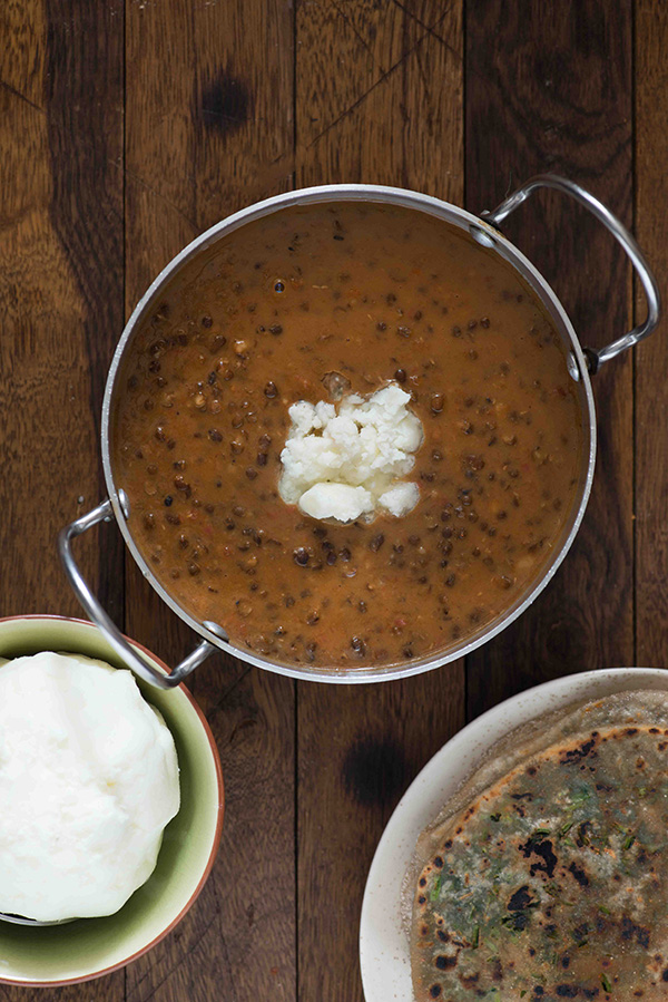 Dal makhani is one of most popular dal recipe in India. A creamy, spicy and buttery dal preparation made with whole Black gram or sabut mah ki dal. The regular restaurant style dal makhani is made using lots of butter and cream, so I usually skip this on the menu and order Dal fry instead