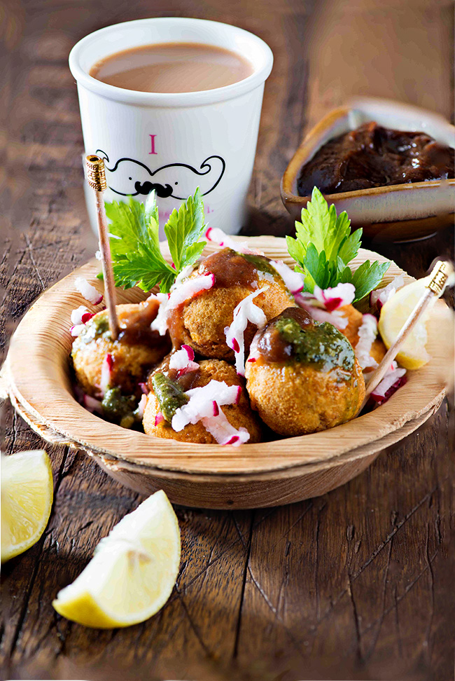 Crispy outside and fluffy inside topped with green chutney and radish is best street side snack ever in winters you can find on Delhi streets.