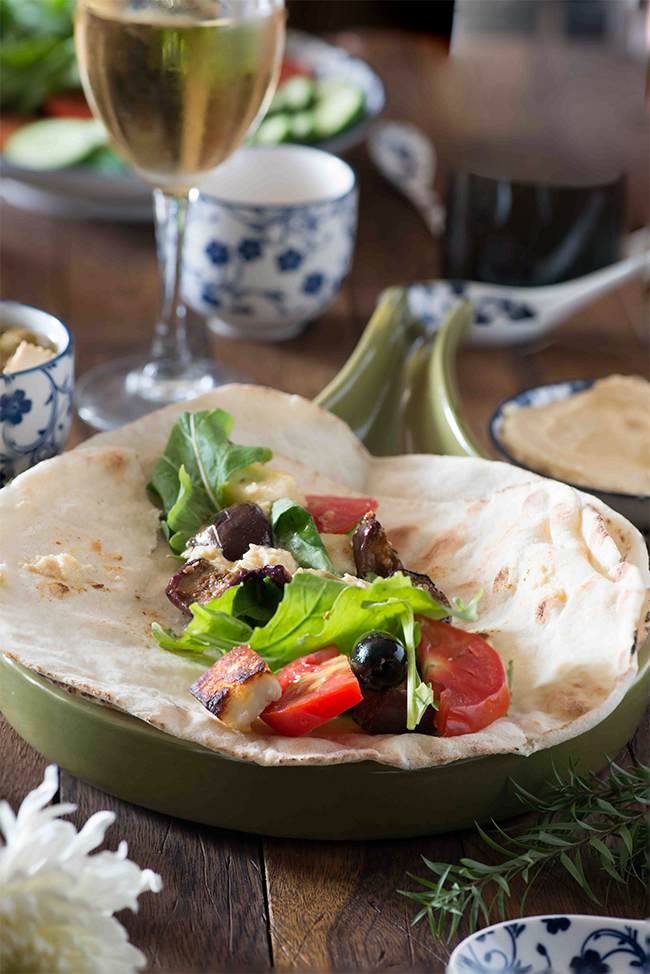 Lebanese eggplant and cheese wrap is an assortment of fresh veggies and H along with za'atar fried eggplant wrapped in an Arabic bread. These wraps are mostly enjoyed and served for the breakfast in the middle east.
