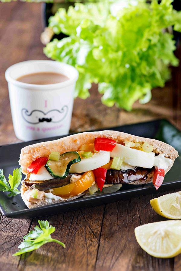 Sabich is Israeli sandwich stuffed with fried eggplants, boiled eggs, salad and assortment of flavourful sauces in Pita bread. The intense flavors of Sabich are so universal that no matter from which part of the world you belong. The first bite will always feel like something familiar. If I have to describe Sabich in one word it would definitely be 'happiness It is an Israeli-Iraqi hybrid dish and was introduced as Shabbat food