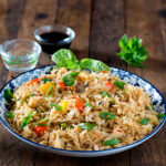 Schezwan fried rice is spicy fried rice cooked along with lots of vegetables and a spicy hot sauce Schezwan sauce. You can make schezwan sauce at home or use the ready made sauce. We love spicy food and Indo chinese food a favourite at home. It's quick, It's spicy and it's tasty and ready in 20 minutes. All you need is lots of vegetables and cooked rice for making this schezwan fried rice recipe. For me making such dishes is always more convenient than ordering a takeout