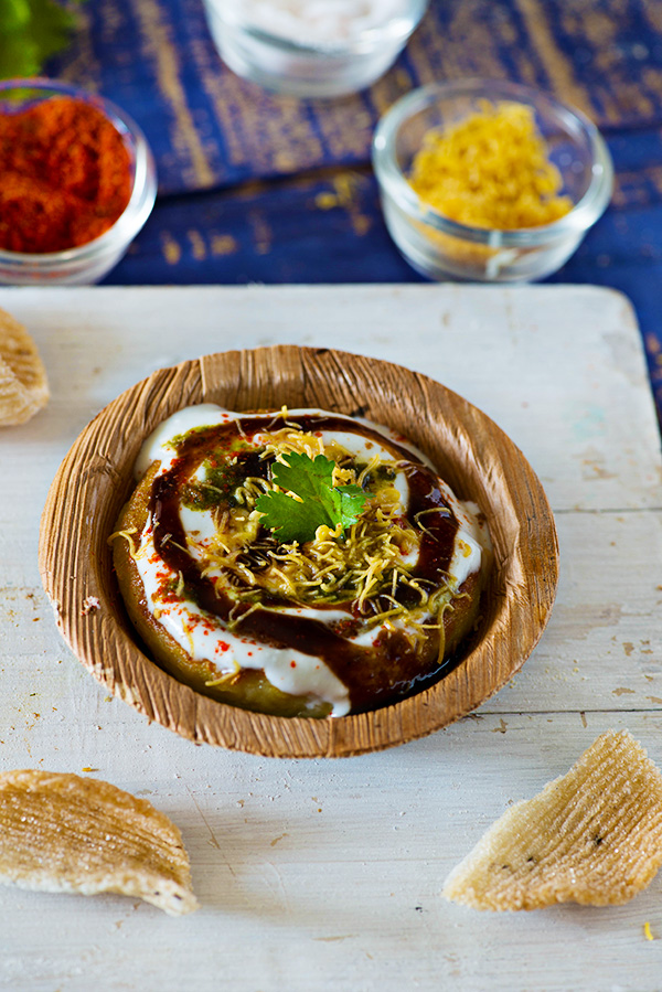 Aloo tikki is a famous street food of Delhi. A crispy and tasty Aloo tikki chaat is popular in North India. It is made with boiled potatoes, mashed and served with a smattering of various sweet and tangy chutneys along with various spice powders.