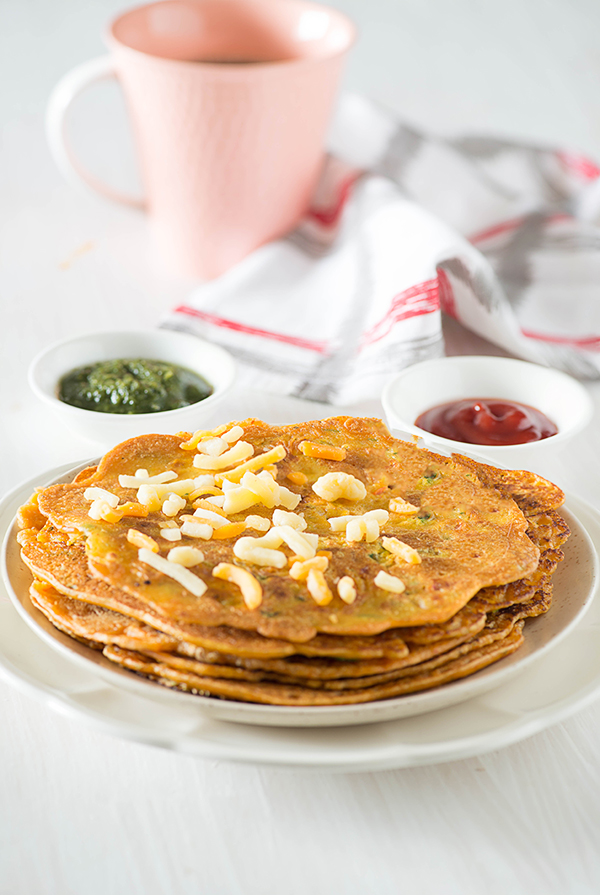 Besan Cheela is tasty and healthy Indian breakfast recipe. Besan ka cheela is also known as Besan ka puda or vegetarian omelet. It is naturally gluten free, vegan and low GI breakfast option. Serve it with green chutney and a chilled glass of chaach or masala chai for a quick tasty and healthy breakfast.