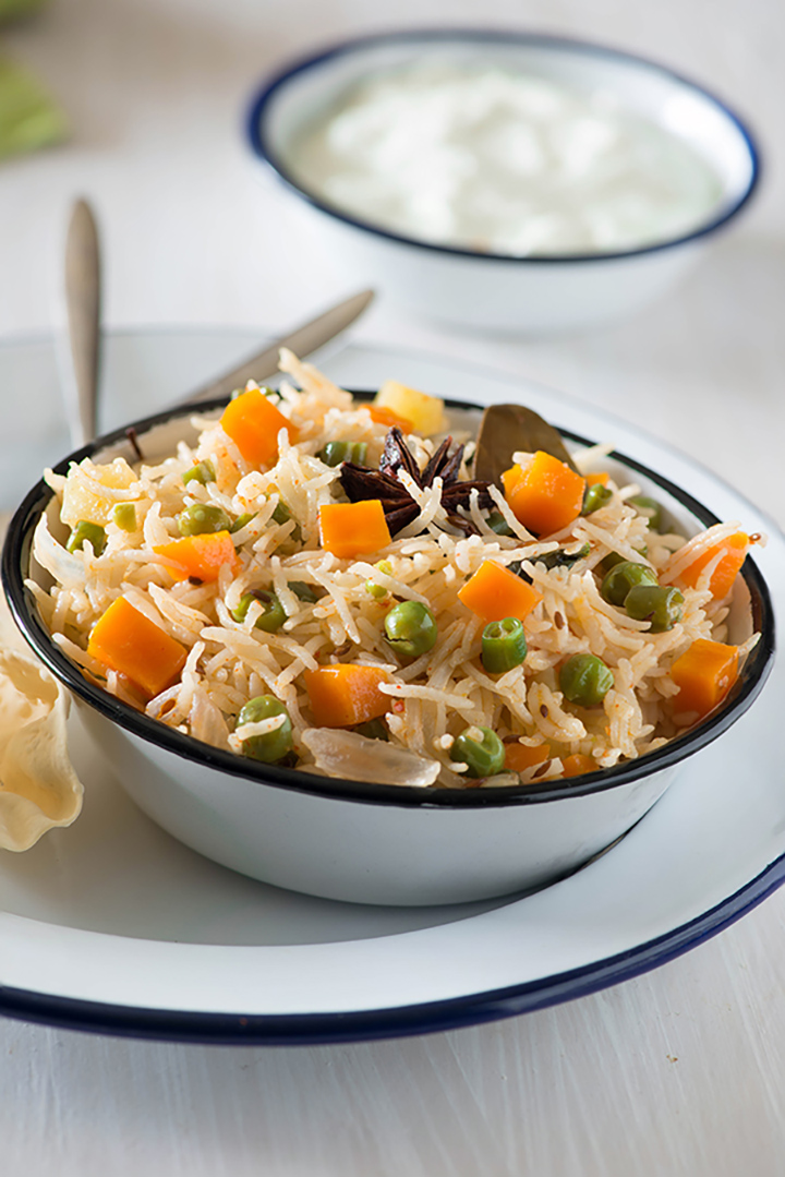 Vegetable Pulao (Veg Pulav) is a One pot dish that makes a complete healthy Indian meal by itself. Made with cooking rice with assortments of vegetables and spices, the Vegetable Pulao is one of the most convenient meal when you want to eat something healthy tasty and homemade.