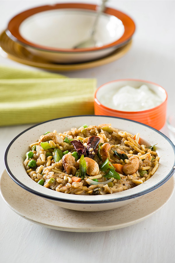 """Bisi Bele Bath or Bisi Bele Hulianna is a dish from Karnataka and is part of Udupi cuisine. This name Bisi Bele Bath means """"hot lentil rice"""" in Kanadda language .The main ingredients are rice, toor dal and vegetables along with some aromatic spices."""