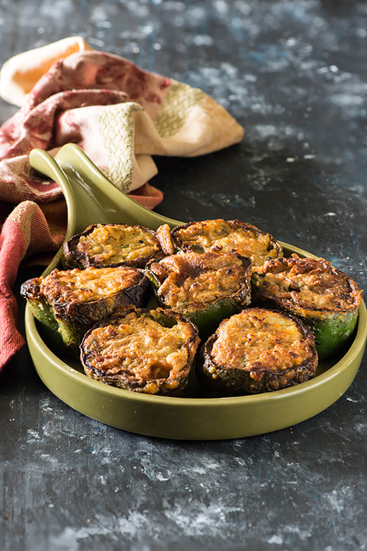 Stuffed Capsicum or Bharwan Shimla mirch Recipe. Punjabi style recipe of stuffed Shimla mirch in which capsicum or bell peppers are stuffed with spicy potato masala filling. Suitable for vegetarians and vegans both.