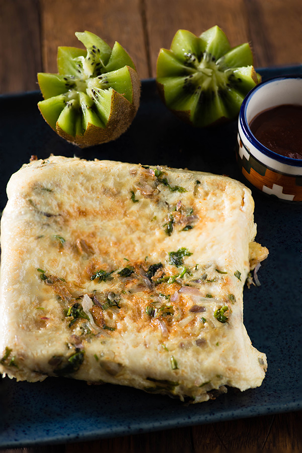 Bread omelet recipe made in Indian street style. Bread omelet is one of quick and healthy Indian breakfast which is healthy and quite filling.