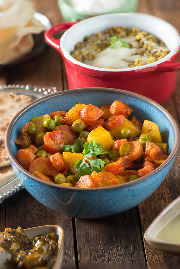 Aloo Gajar Matar recipe without onion and garlic. This is a Punjabi style dry sabzi made with very few spices and new potatoes, fresh peas, and winter red carrots.
