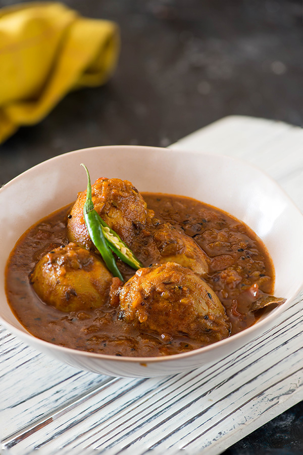 Dimer Dalna or Bengali egg curry recipe is a lightly spiced egg curry. Hard-boiled eggs are fried first with salt and turmeric powder and then added to the flavourful curry.