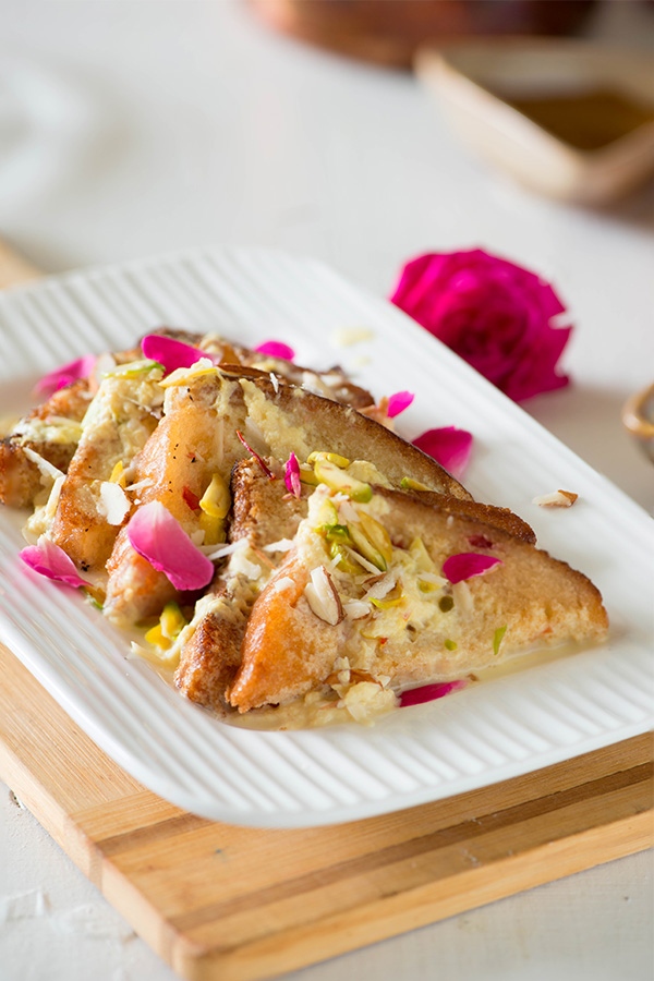 Double ka meetha, easy rich and a delicious delicious Indian bread pudding from Hyderabadi cuisine. A delicious Indian bread pudding in which fried bread is soaked in thick saffron flavoured milk.