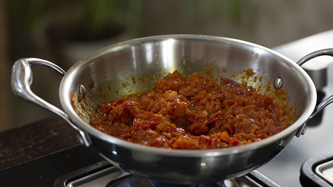 Cooking onion tomato masala for Indian gravies